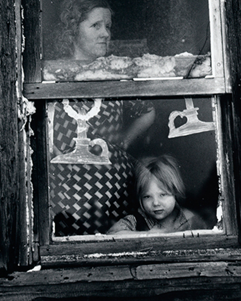 Arthur Rothstein, American,1915-1985, Wife and Child of Submarginal Farmer at Their Window Decorated for Christmas 1937