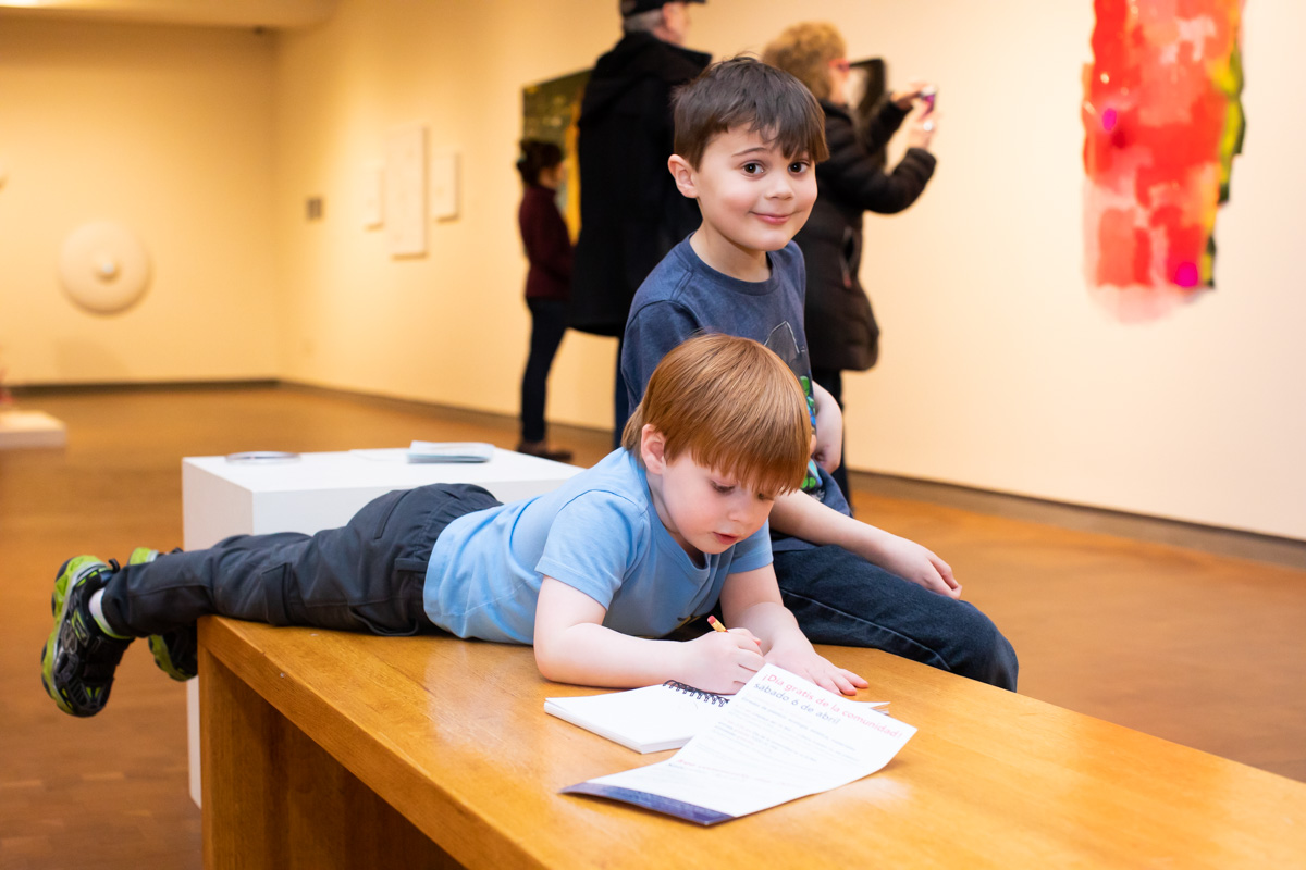 Kids on a bench enjoying and exploring the galleries