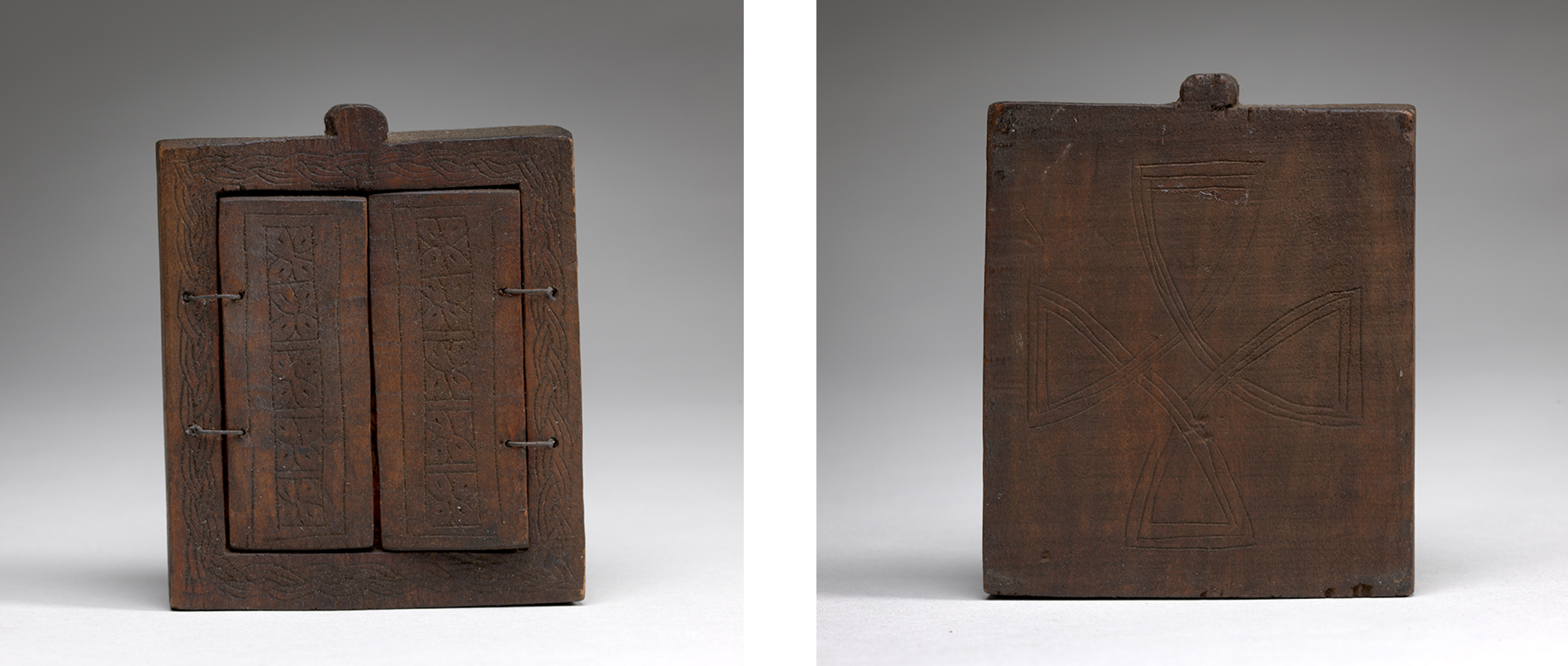Images of the dark wood triptych closed from the front and back. Closed front view: two twine hinges join the outside seam of either side panel and the frame of the center triptych. Each center panel is carved with a mosaic design and the outer frame of the center panel is carved with a braid pattern. A small knob-shaped protuberance crowns the center of the triptych. Back view: a cross is carved into the dark wood back of the center panel. The wooden knob-shape is also visible.