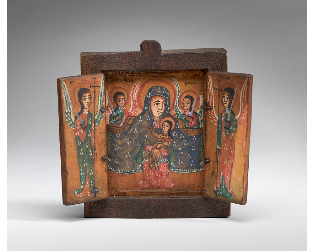 Image of a square, wooden triptych. On the central panel, the virgin, cloaked in blue, and child are flanked by two angels holding swords. Each side panel depicts an angel dressed in green and red holding a staff and a sword.