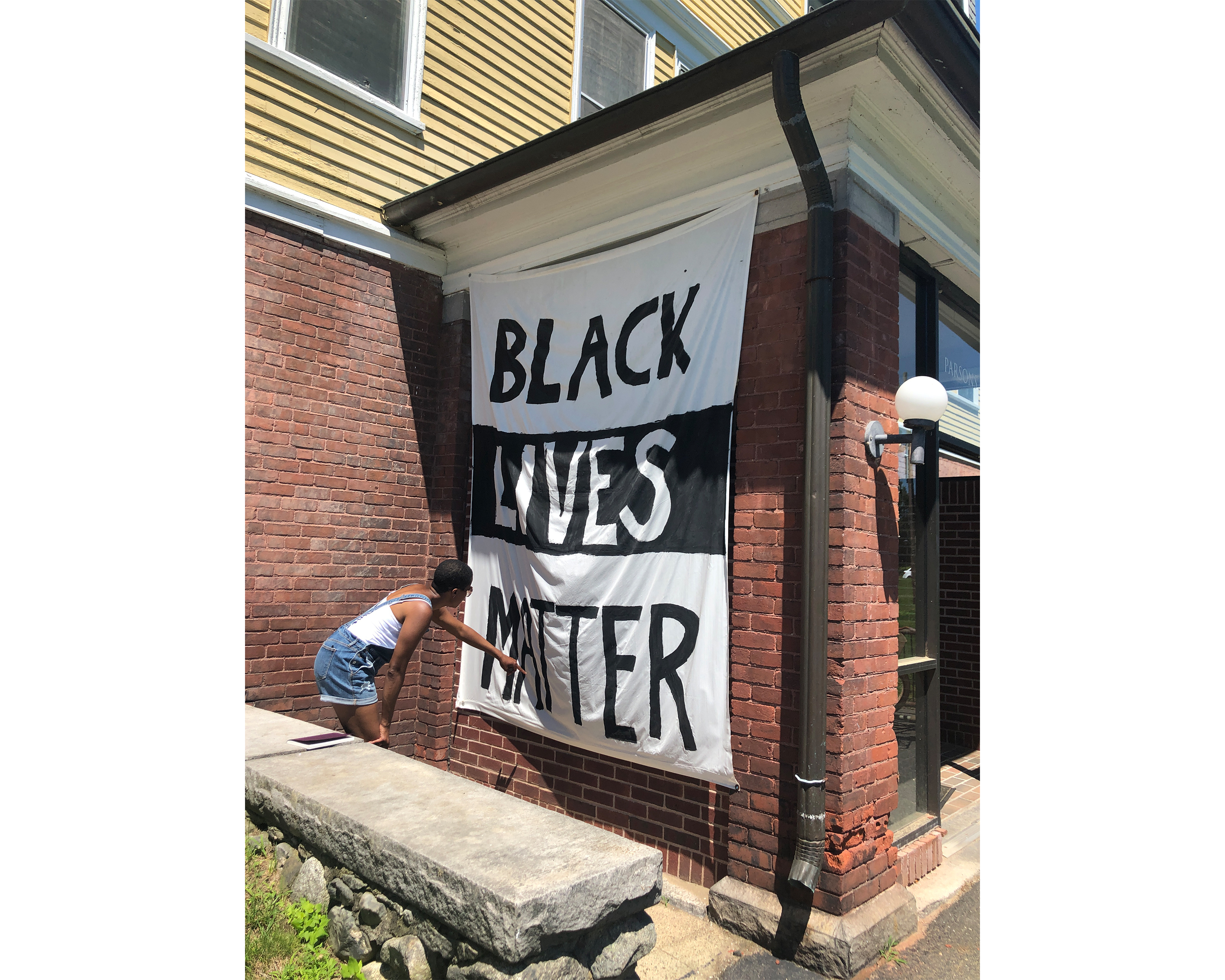 Amanda Williams next to a Black Lives Matter banner outside a Smith College house/dorm
