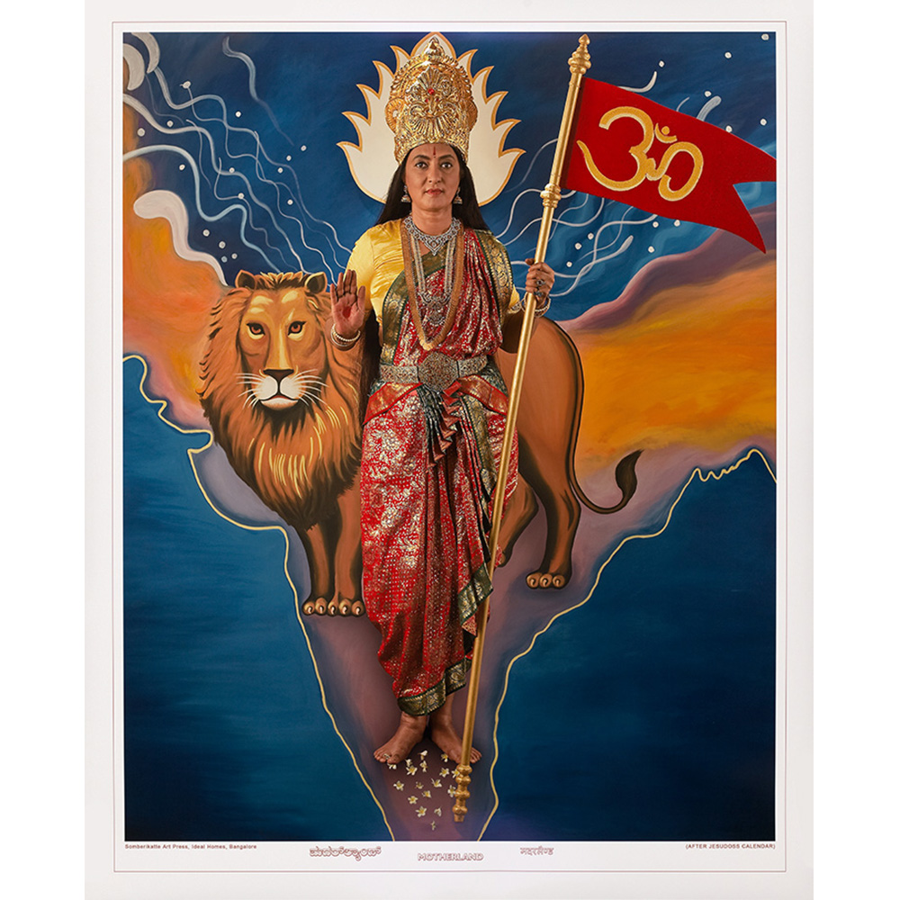 Photograph of woman with a lion holding a red flag with om symbol.