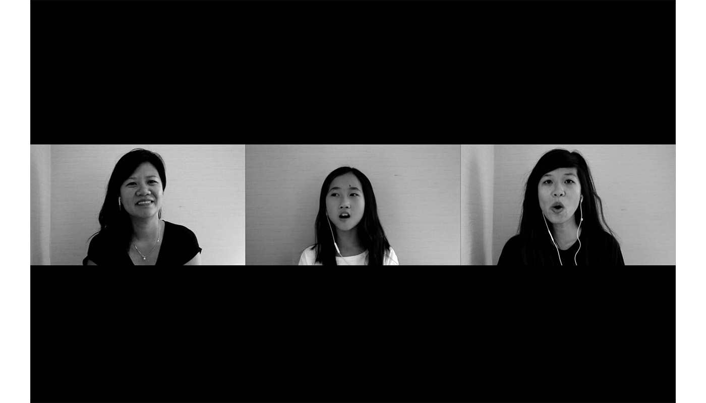 three side-by-side screens appear with two sisters in black shirts, the artist on the right, her sister on the left, with the artist's young niece in a white shirt in the center, wearing white headphones against a light background; all three have long dark hair