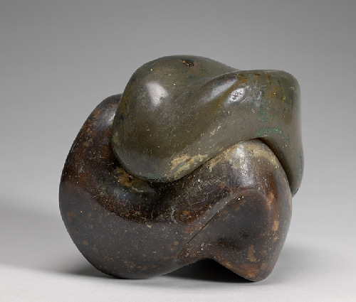 sculpture in two undulating parts that fit together in a cube-like shape; smooth yet textured surface; one half is more green in tone, other half is a richer brown