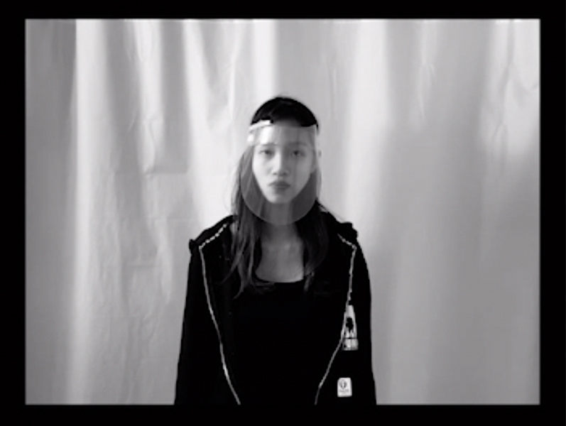 Screenshot of student wearing a face shield in black and white.