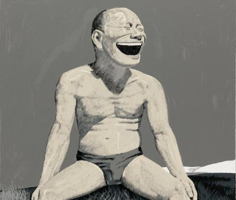 Widely grinning figure in bathing trunks sitting wide-legged on a grassy mound, low hills in background at mid-right, grey sky.